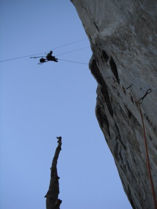 Erik cleaning one of the overhanging bolt Ladders at the start of The West face of Leaning Tower on rappel
