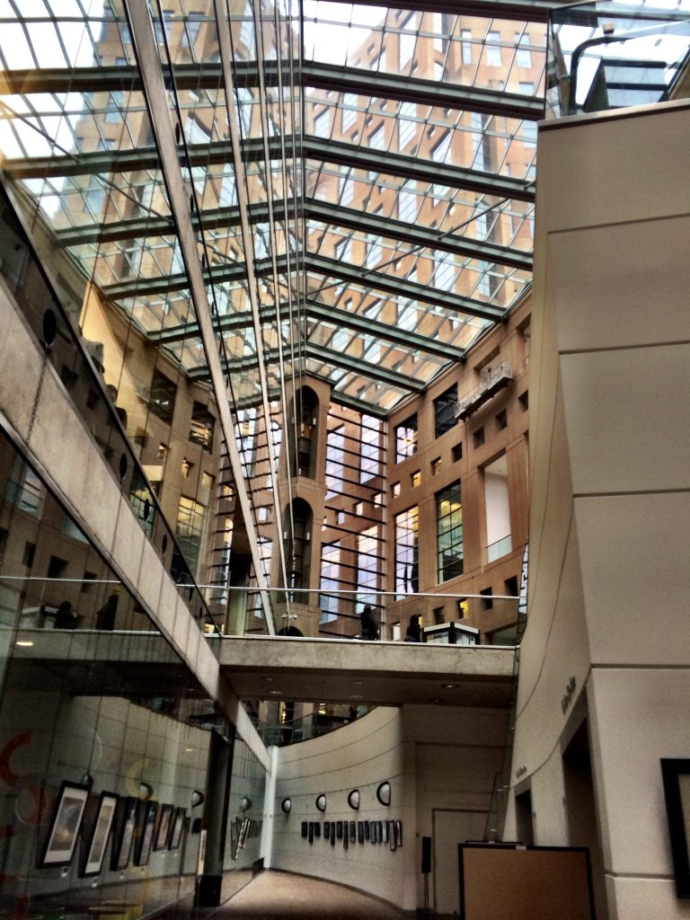 Inside the covered foyer of the Vancouver Public Library Central Branch