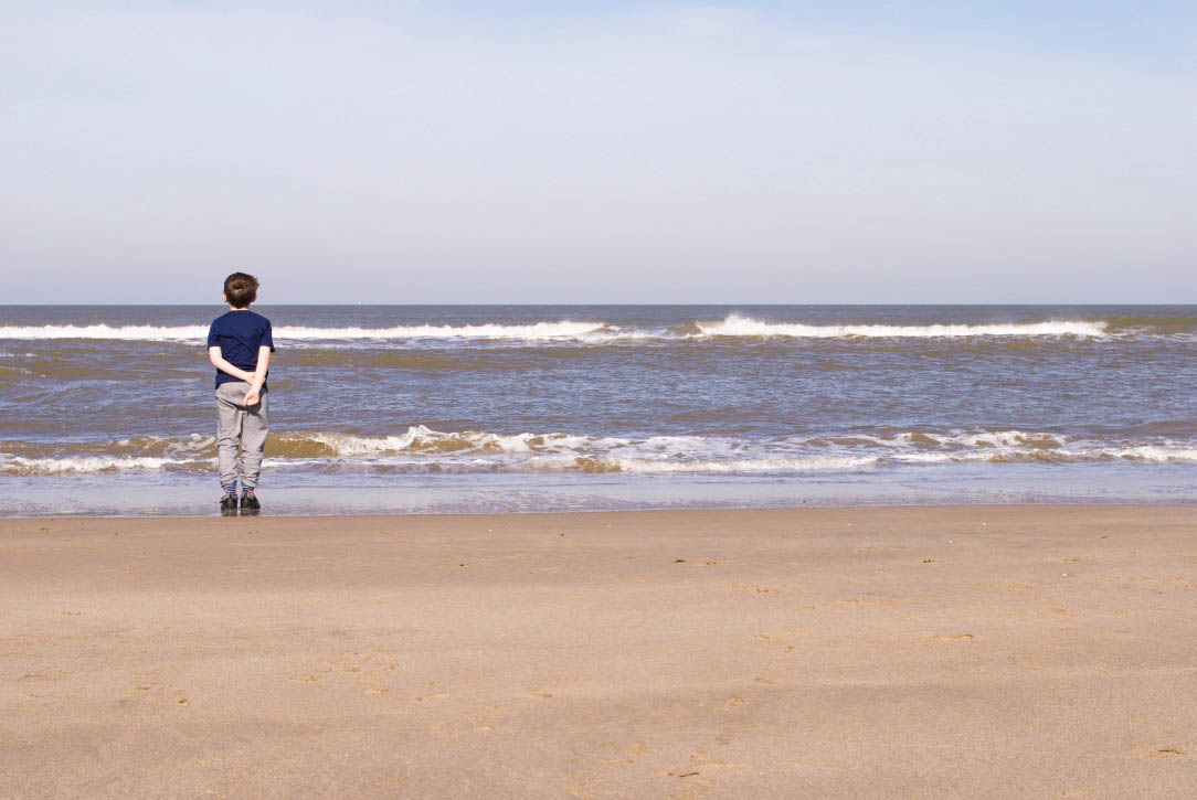 My son looking out to sea at National Park Zuid-Kennemerland