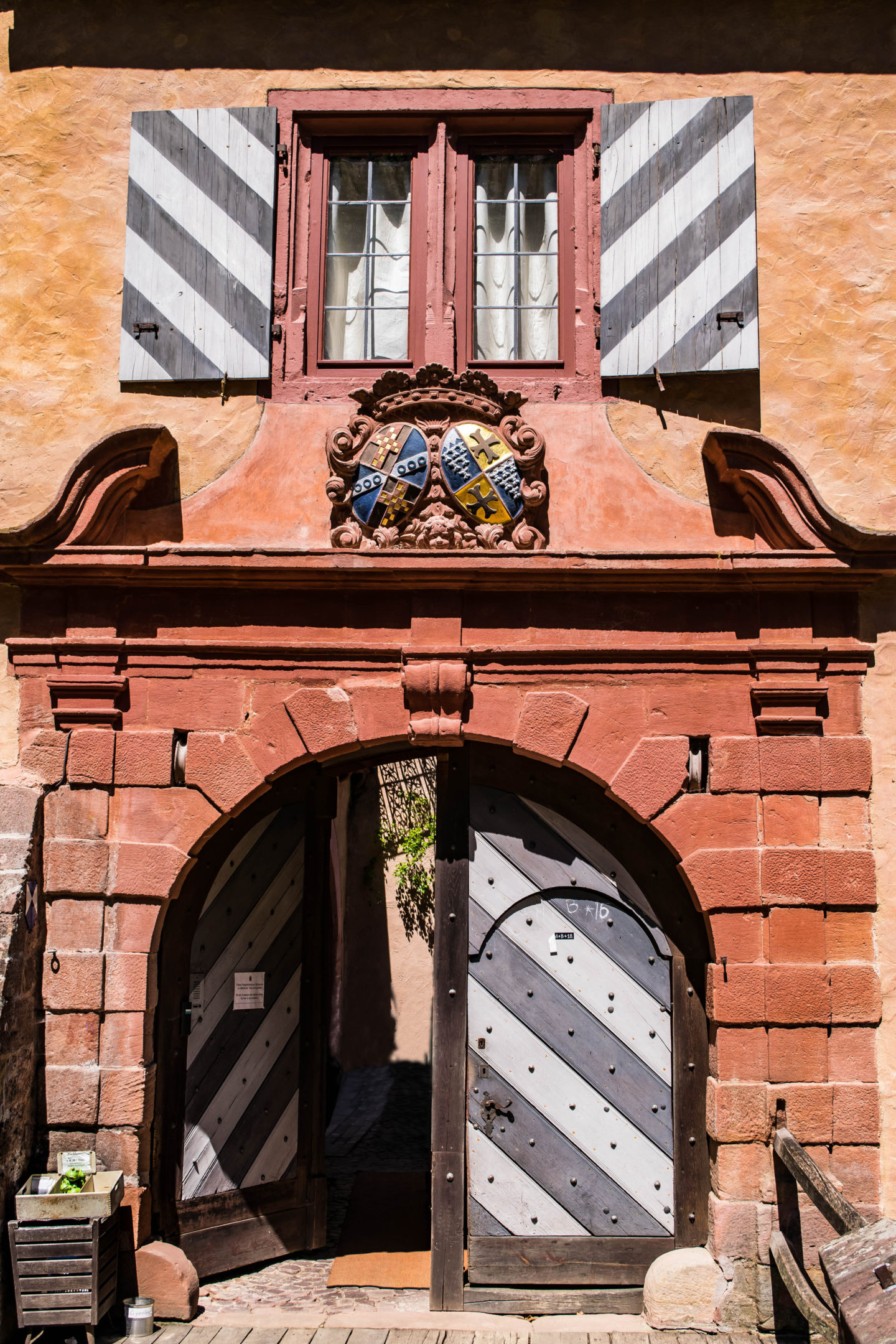 The doors to the Castle Mespelbrunn. You can see the little crate that holds the fish food on the lefthand side there.