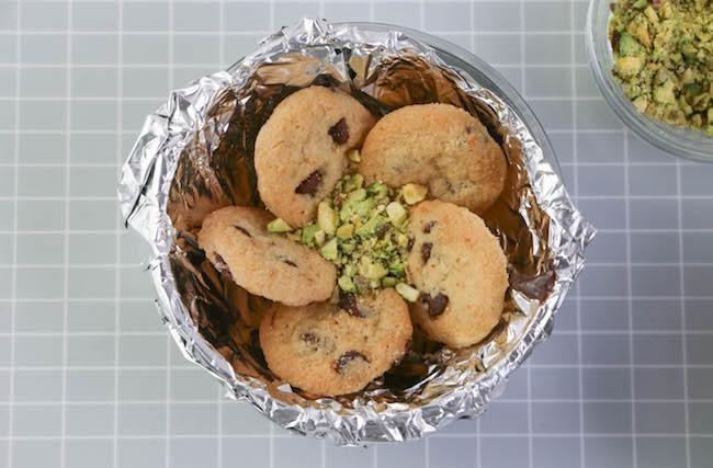 Adding chopped pistachios to the center.   Erin Gardner   Erin Bakes