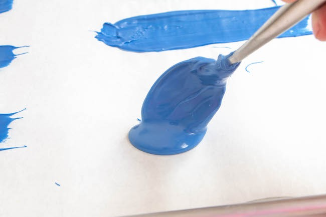Pouring Melted Chocolate onto Parchment Paper   Erin Gardner   ErinBakes