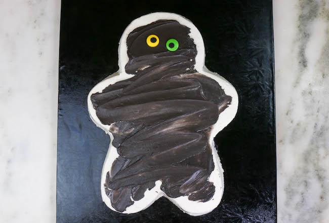 Adding Candy Eyes to the Mummy Cake   Erin Bakes