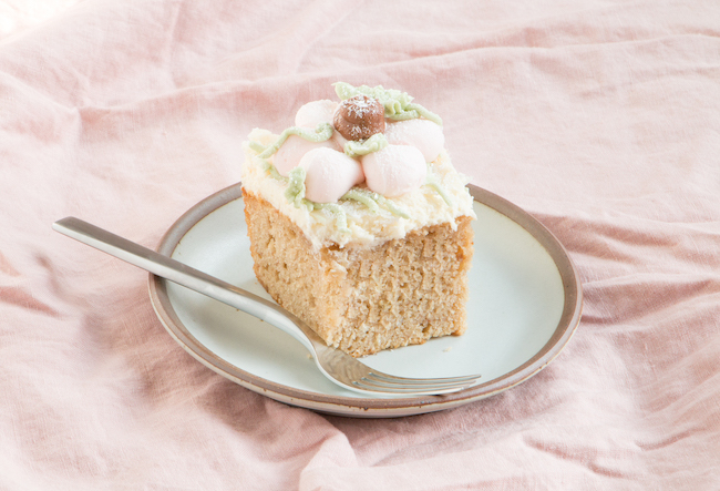 Slice of cranberry sauce spice cake with cream cheese frosting