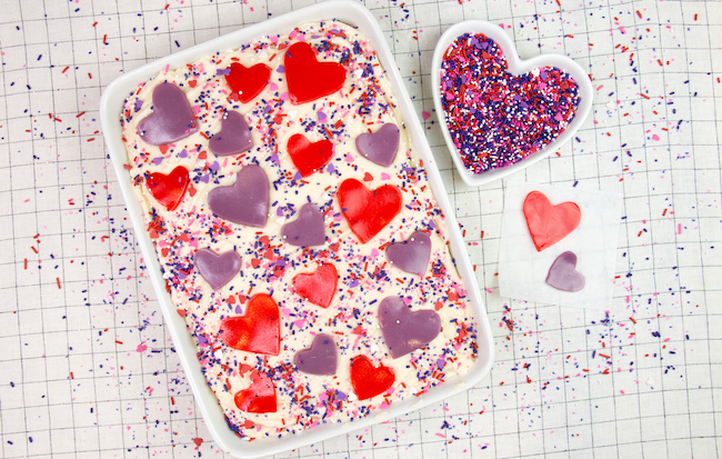 Sheet cake decorated with sprinkles and hearts made of gelatin