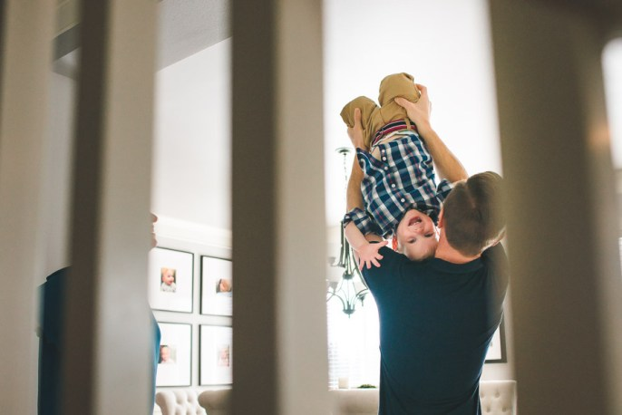 Issaquah family photographer captures moment when young boy is lifted in the air