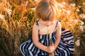 Kirkland family photographer captures photo of a young girl smelling a flower