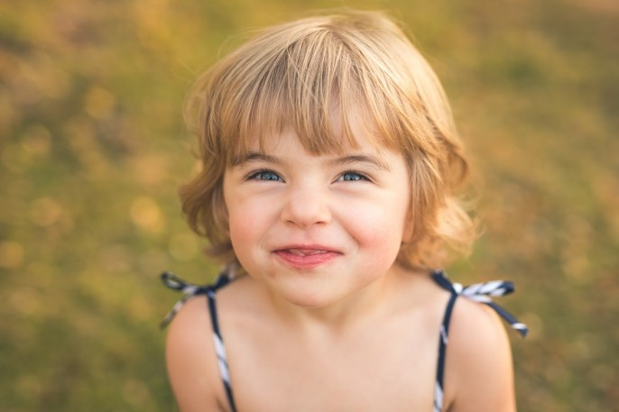 Kirkland family photographer captures photo of a young girl smiling happily
