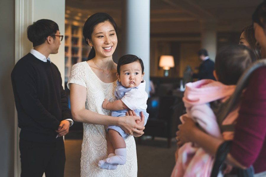 Woman and baby greeting party guests