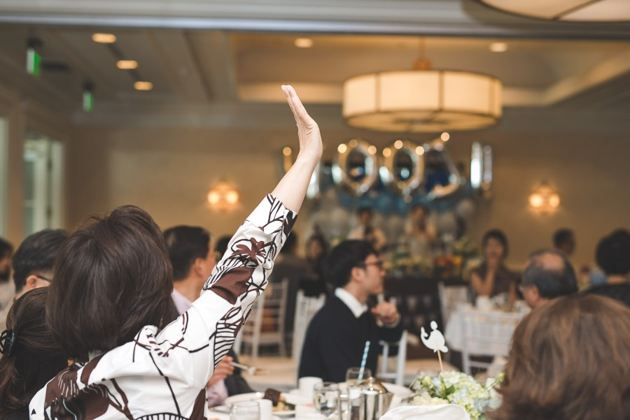 Woman raising her hand during a party