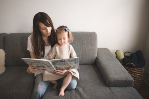 Mother and small child reading a book