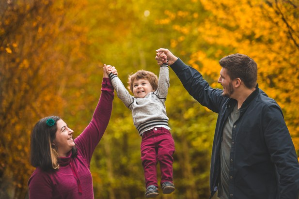 Parents holding their son in the air by Bellevue family photographer bellevue wa