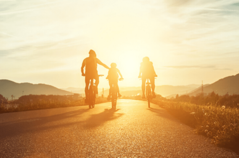 Family Riding Bikes in the Sunset