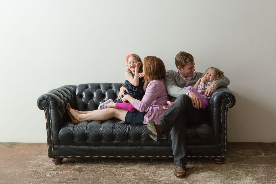 Family of 4 on a leather couch