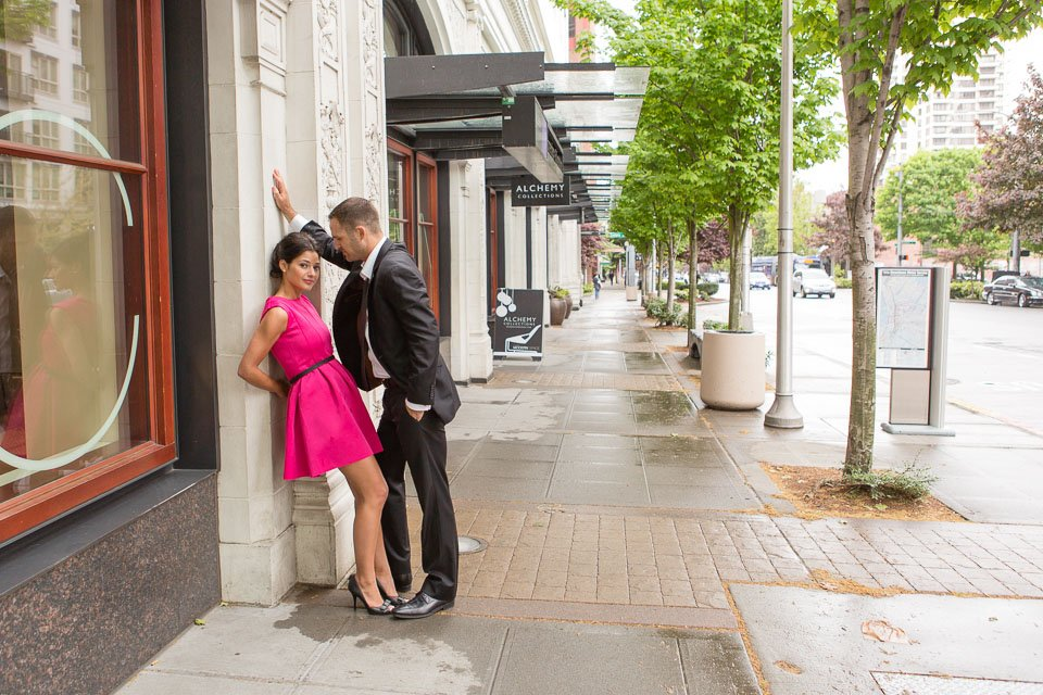 couple on seattle sidewalk leaning against wall