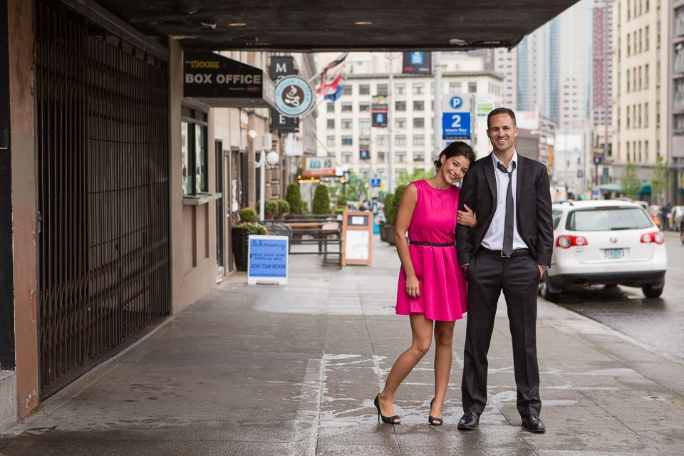dressed up couple on seattle street under awning