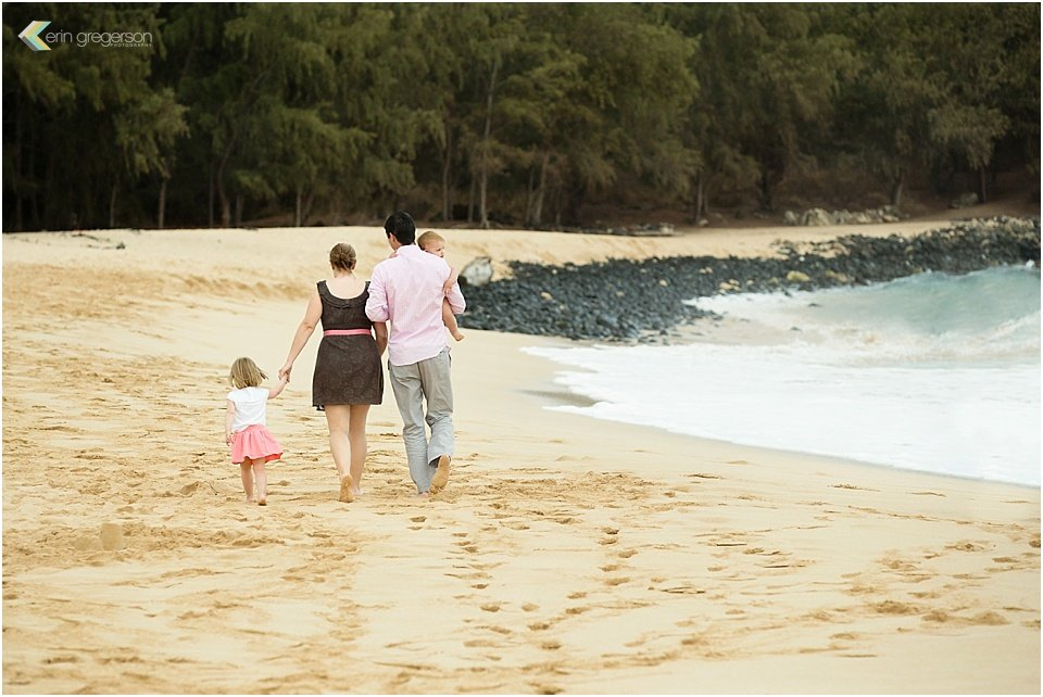 family photographer in kauai-family of 4 walking on beach by erin gregerson photography