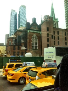 Yellow cabs, tall buildings