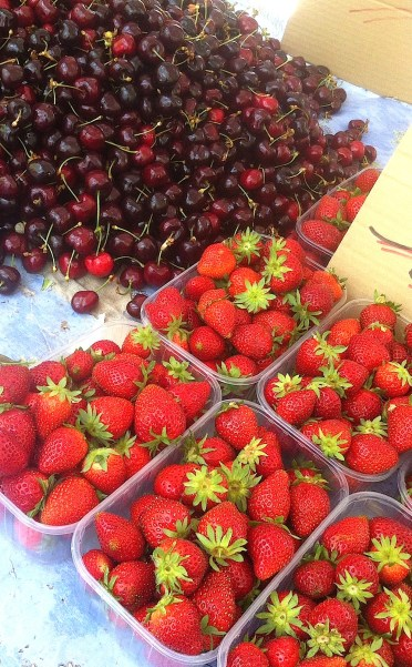 Strawberries and cherries at the market