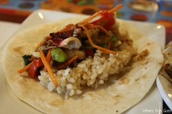 I added my Thai-peanut flavored stir-fry and a scoop of brown rice to a tortilla. (Photo by Erin Klema)