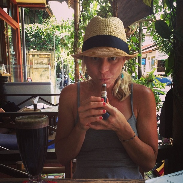 Me drinking Royal Jelly at Juice Ja in Ubud, Bali with my new friend Yogi Nora (she's taking this picture :)