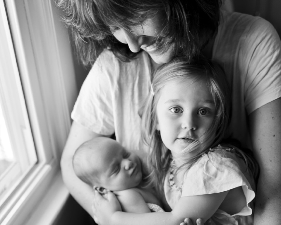 In Home Newborn Session, Mother holding baby, Erin Tetterton Photography, Washington DC Newborn Photography