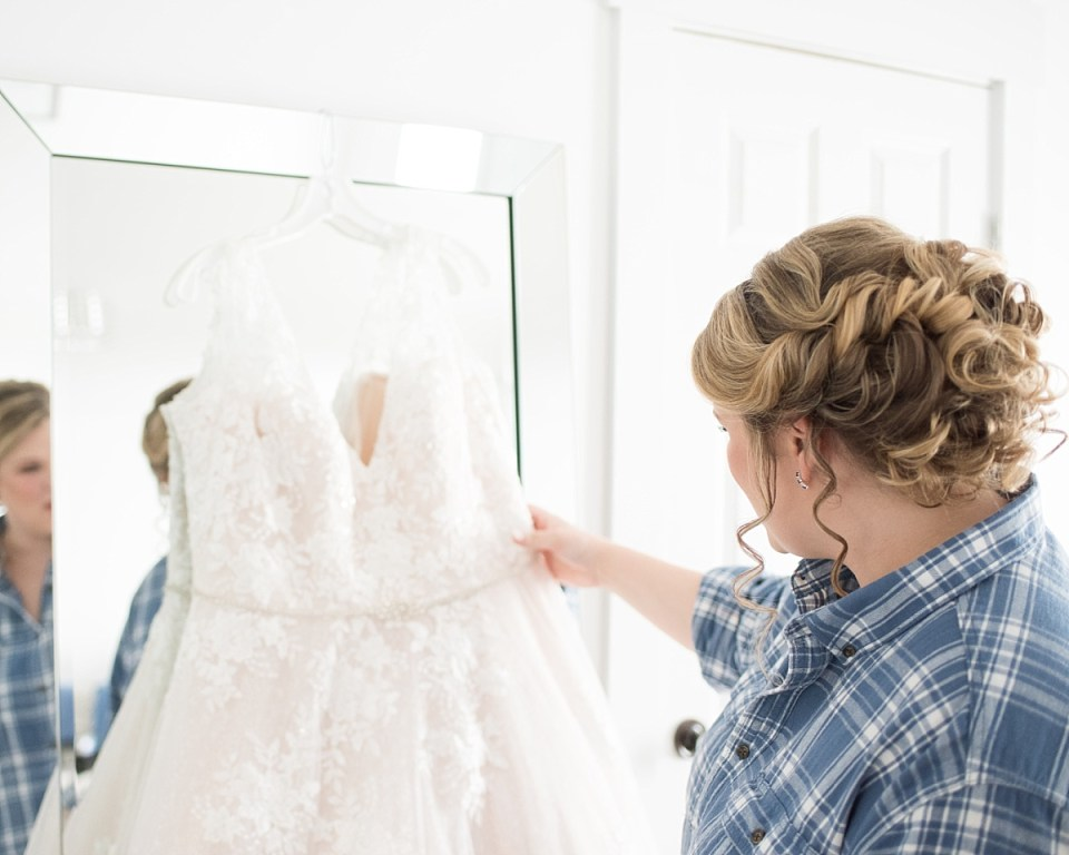 Bride getting ready at the farmhouse at 48 Fields Barn