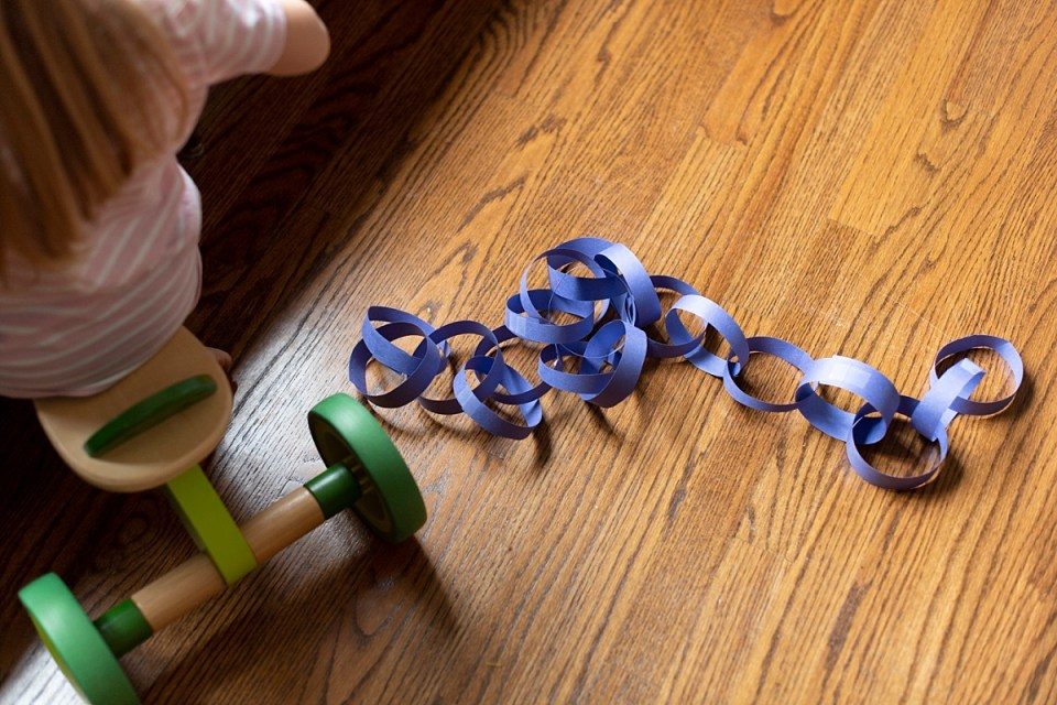 Creating a paper chain - easy indoor crafts to do with kids