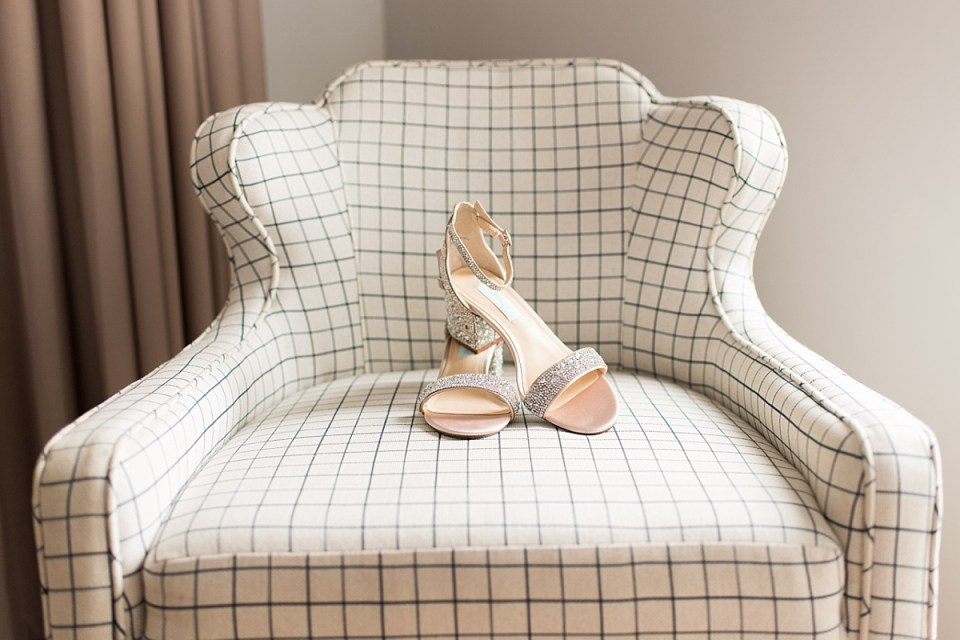Wedding Details in pink on plaid background at Hotel Indigo at and Old Town Alexandria Wedding