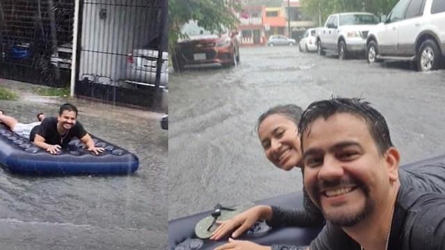 Pareja da paseo sobre colchón inflable en el huracán Hanna