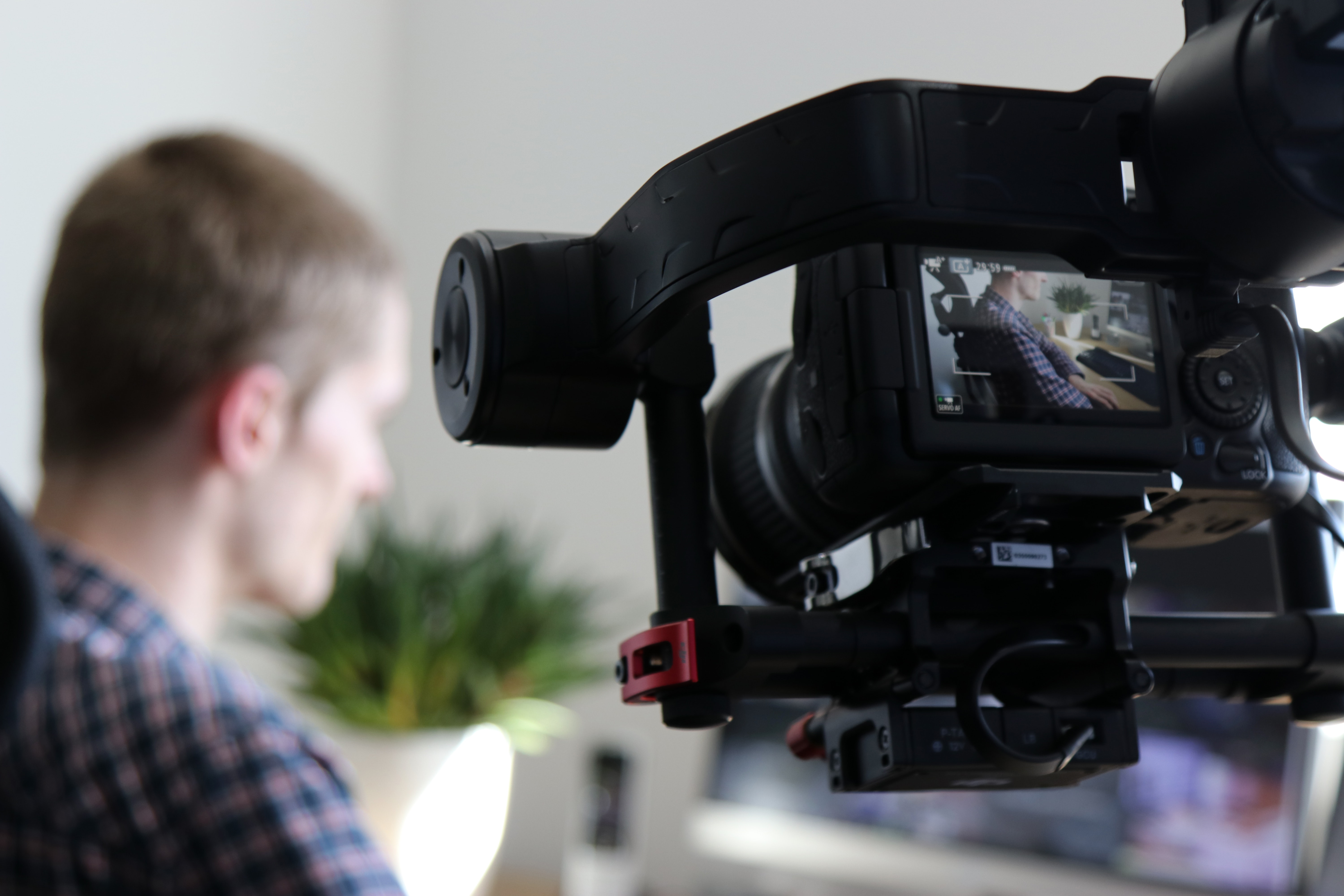 video camera zooming in on a man working