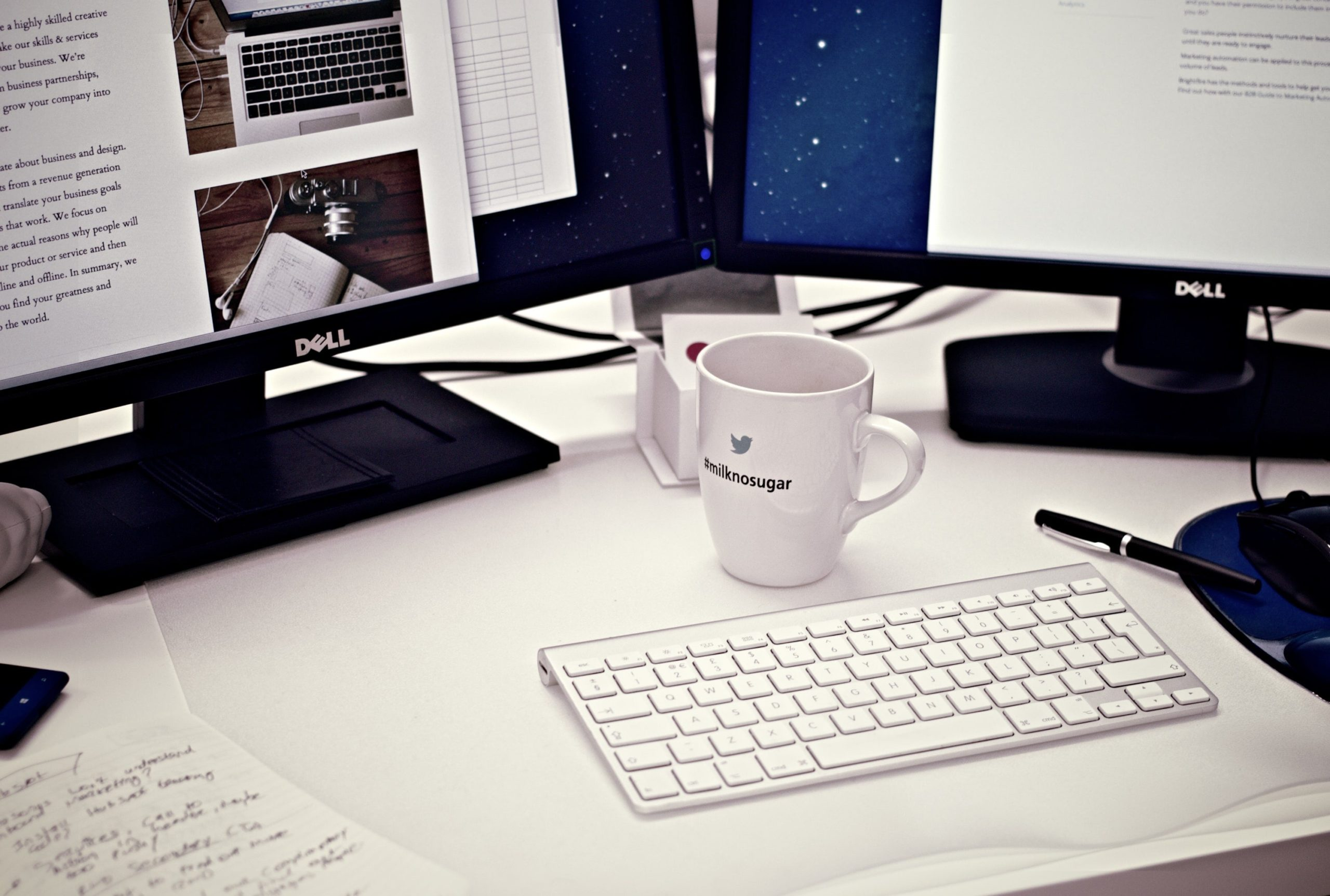 mug and keyboard on white desk
