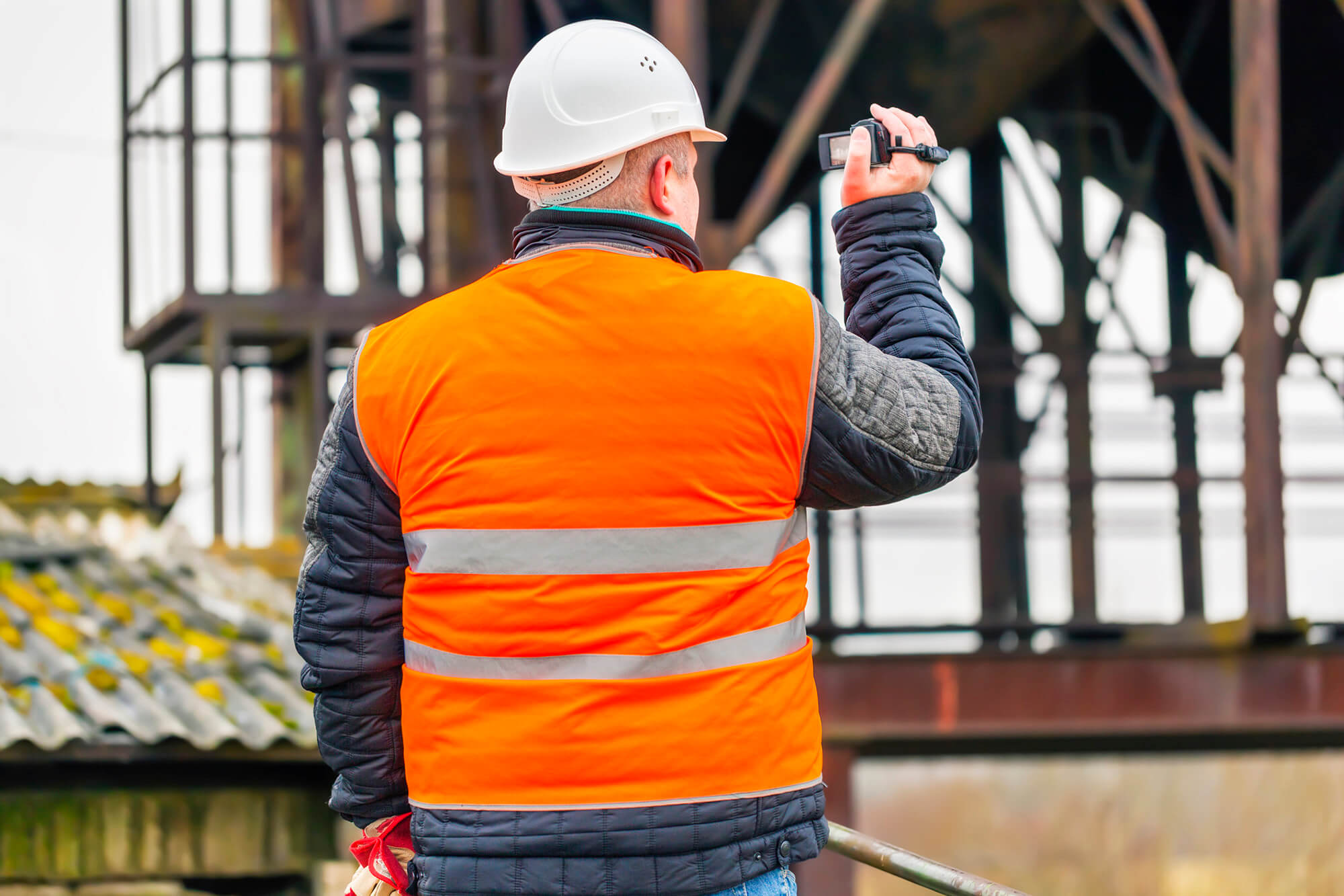 Construction contractor at job site filming youtube video on camera