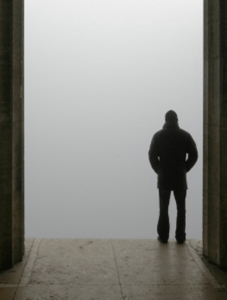 Man in front of foggy abyss