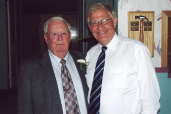 Doug Topham and Ernie Hardeman at Doug and Isabell's 50th wedding anniversary.