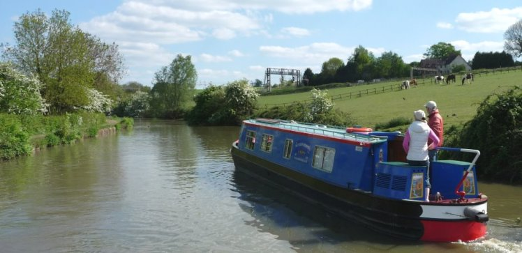 Canal boat from Wyvern Shipping Company out on the water