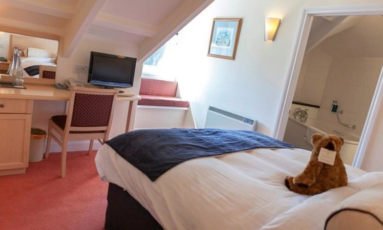 Bedroom at Hotel Penzance with teddy bear on the bed