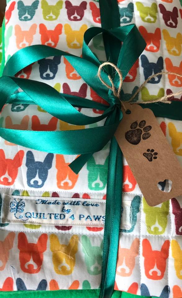 Quilted 4 Paws quilt showing logo
