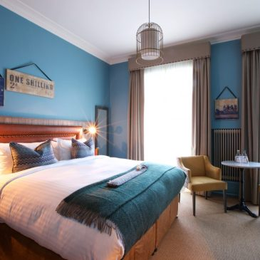 Stylish blue bedroom at the White Horse, Dorking