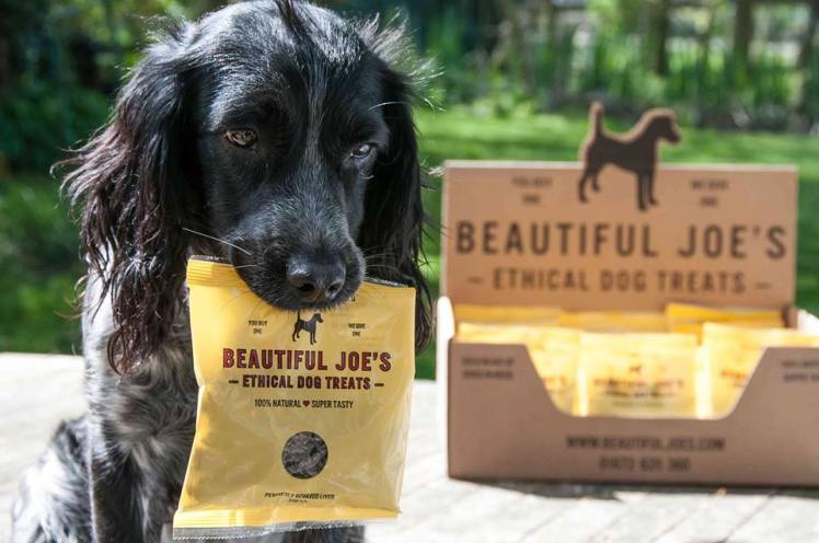 Dog with a packet of Beautiful Joe's treats