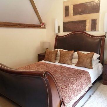 Our Premier room at the Fat Fox Inn, Watlington, with handmade sleigh bed