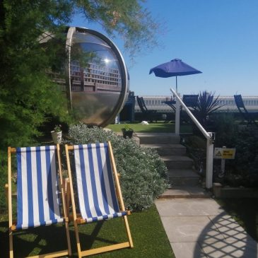 Deckchairs and dining pods at The Beachcroft Hotel's Garden Terrace