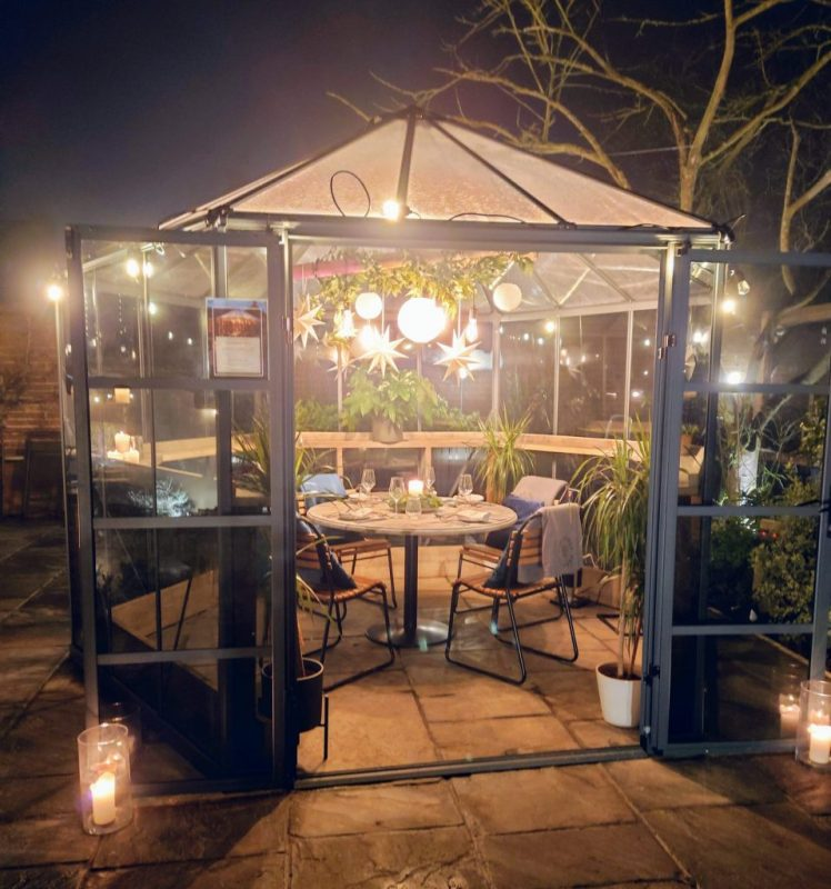 Stylish glasshouse in the courtyard garden