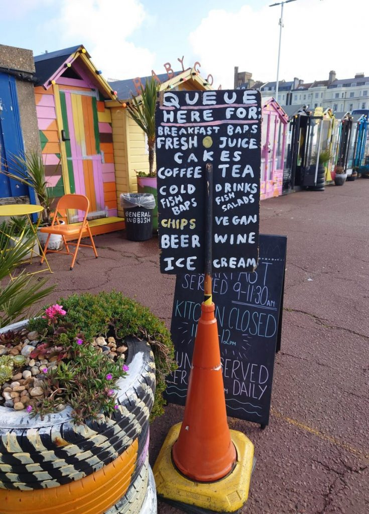 Colourful beach huts at Goat Ledge cafe, Hastings