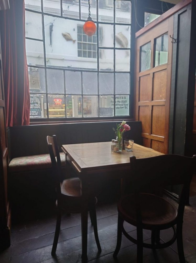 Table in the window of the Albion, Hastings