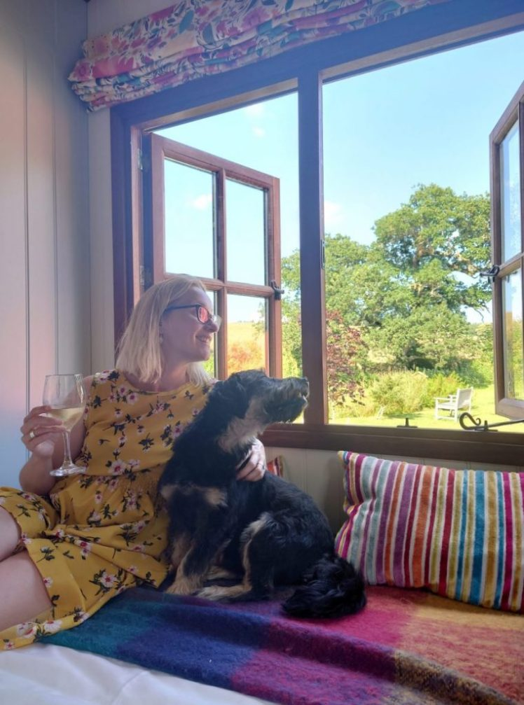 Me and Stan look at the blue skies out the window of our shepherds hut