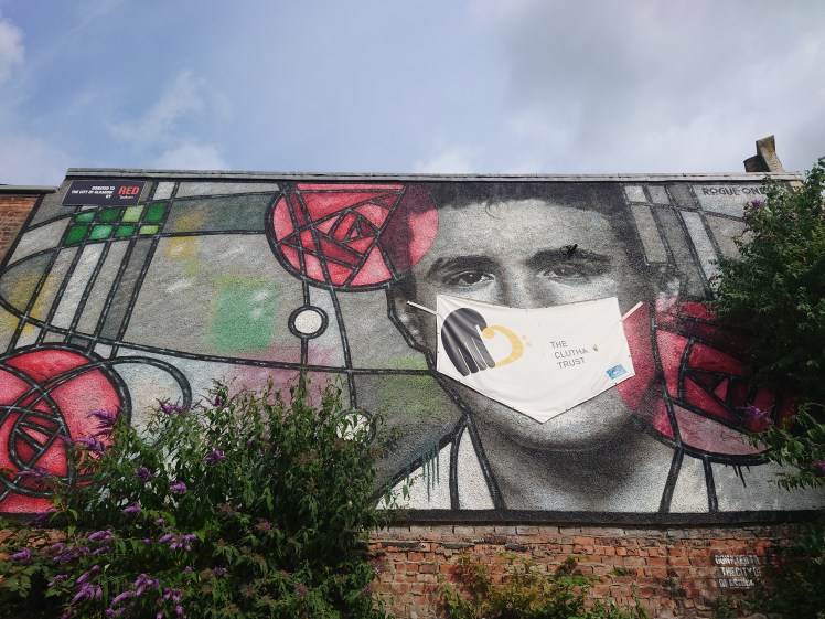 Charles Rennie Mackintosh mural outside The Clutha, Glasgow - complete with mask