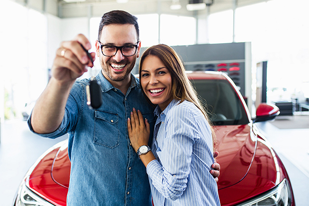 Happy Couple with Car Keys