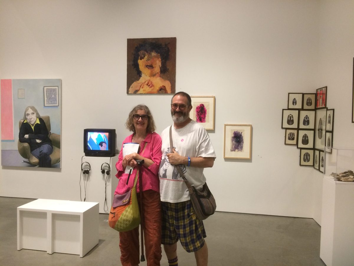 Linda Mac and Michael LaBash in front of Patti Smith paiting