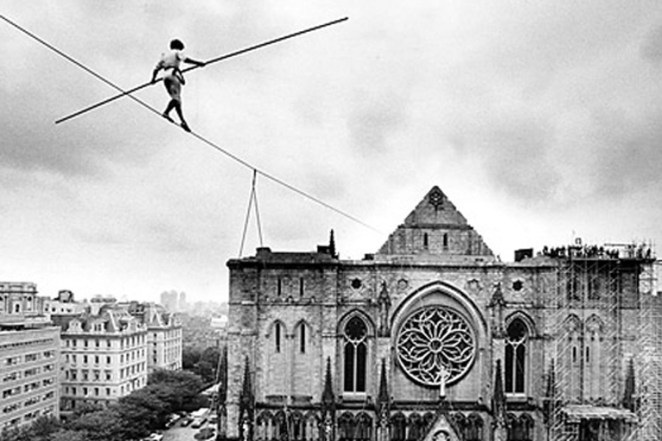 Aerialist Philippe Petite opens dedication of St.John The Divine. Credit: Fred R. Conrad / The New York Times, 1982